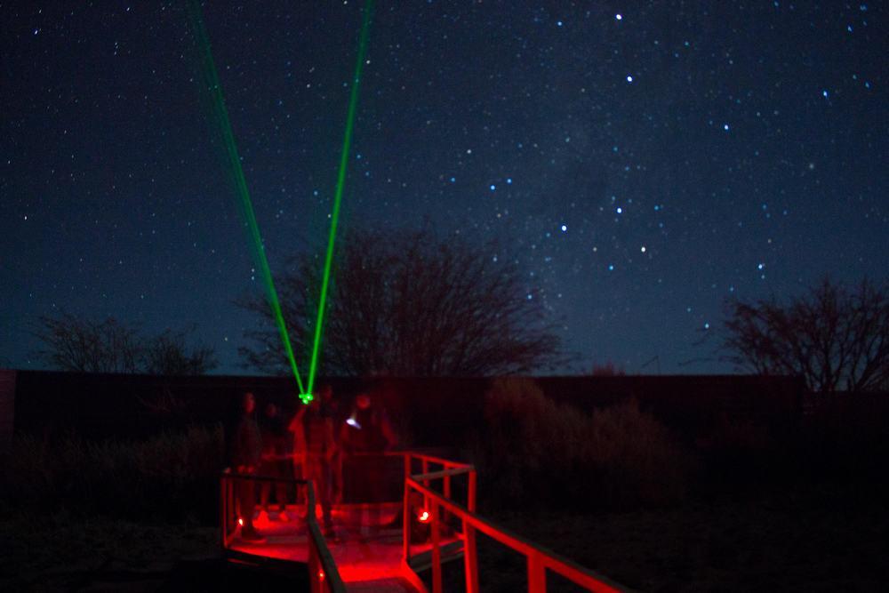 stars laser sky night