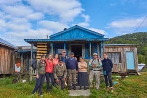 Mapuche family at their local housing on the pacific coast